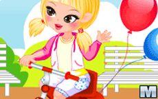 Vesti il bebè sul triciclo